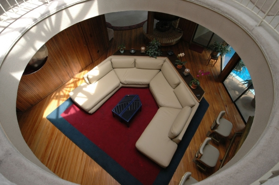 Looking down into the family room from the walkway above