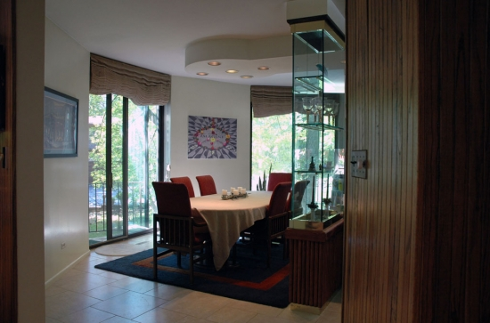 The dining room and kitchen are separated by a built-in cabinet