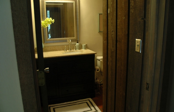 The lower full bath has also been remodeled recently but still retains the original, warm cedar
