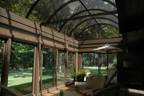 The sunroom offers nearly unobstructed views of nature in all directions