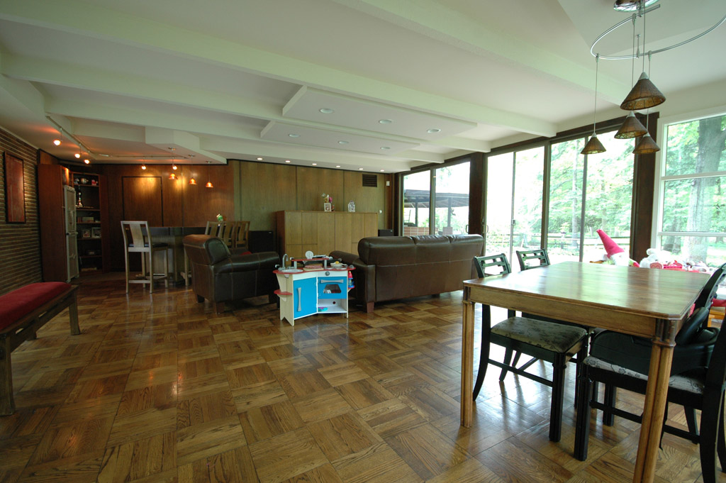 The family room features a bar near the door into the garage