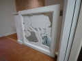 One of two original carved wood panels, this one on a gate going to the basement