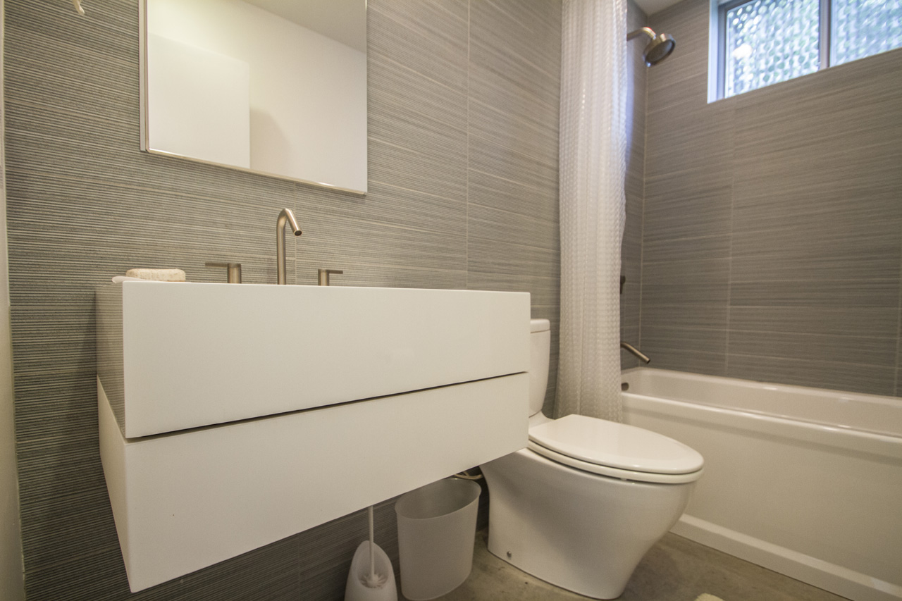 The second full bath features a combination shower / tub and the same clean lines as the Master Bath