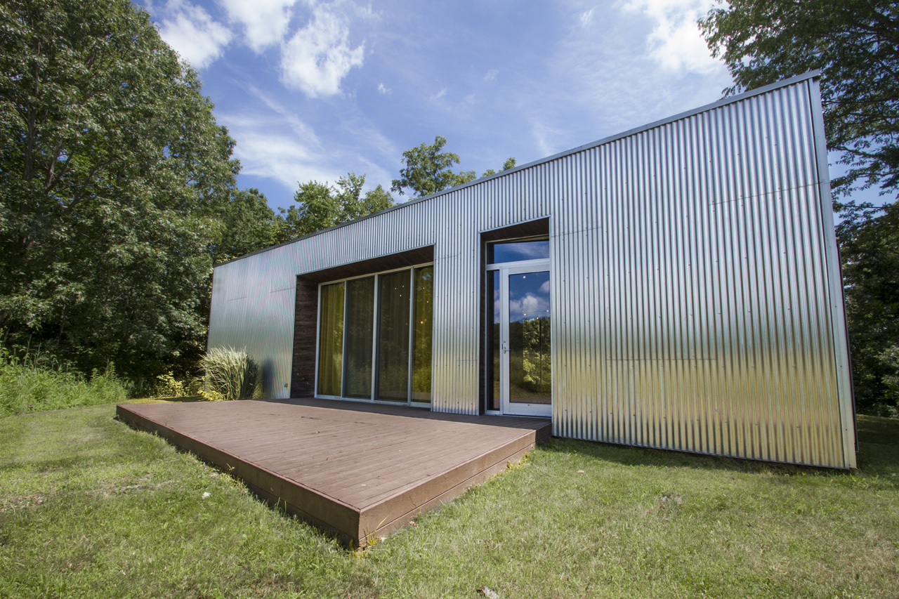 The exterior is clad is corrugated aluminum, echoing the rural aesthetic of the area