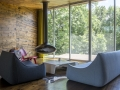 The Living Room features a Fireorb and views out to the rear of the property that only hint at the 21 acres upon which the house sits