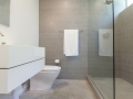 Modern fixtures with Italian tile result in an elegant master bath with clean lines