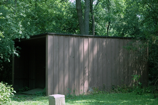 The shed that Rick built to match the home. It looks like the garage had a baby!