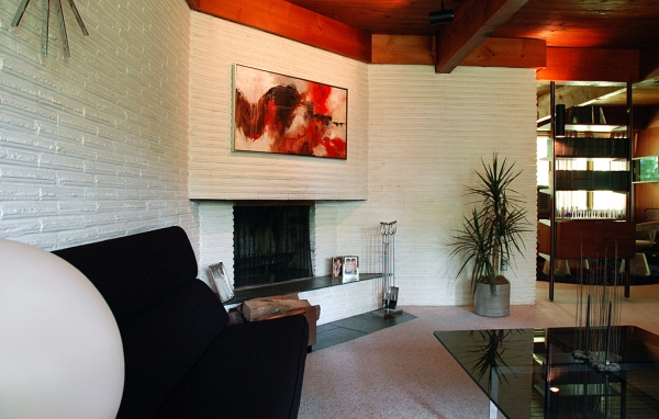I love that the fireplace is at an angle, breaking up the grid formed by the perpendicular lines in the space.