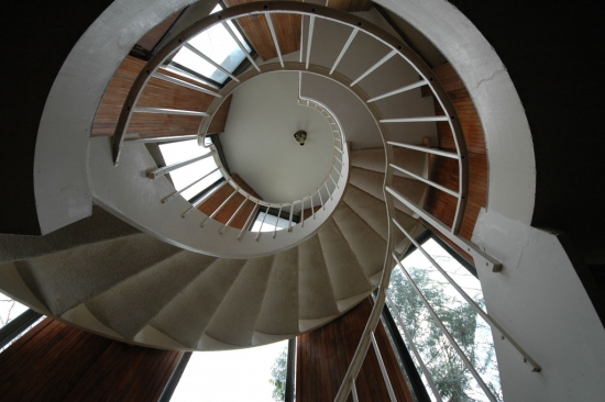 The entryway is three stories, with a spiral staircase connecting all three floors
