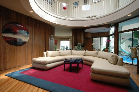 This view of the family room shows off the repeating circular forms, including a circular art piece made for a previous owner
