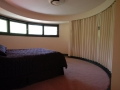 The round master bedroom
