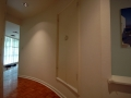 The hallway outside the master bedroom, with a broom closet