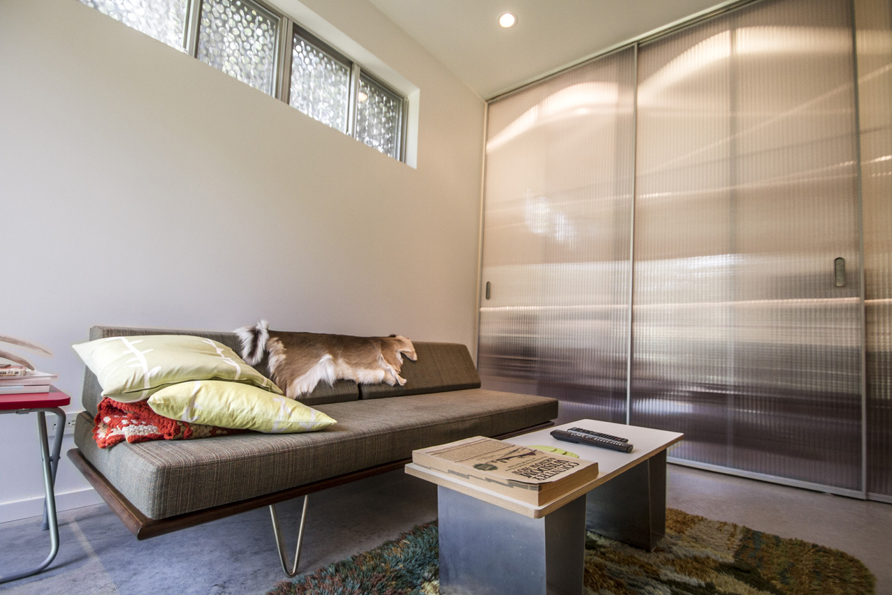Both 2nd and 3rd bedrooms feature triple sliding translucent doors that offer privacy to the rooms and reveal / close off the closets