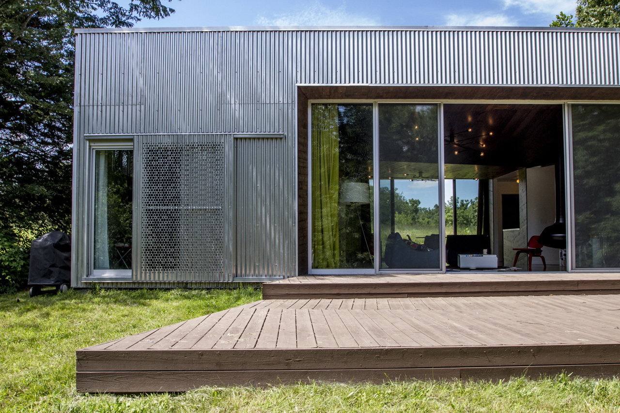 The rear deck is the perfect place to grill out and enjoy nature