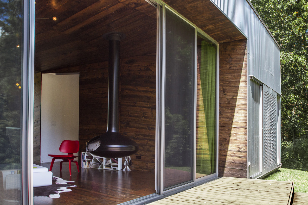 Both front and rear walls of glass open to the expansive decks