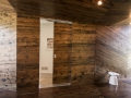 """Clever hardware allows the doors to """"disappear"""" into the walls when closed"""