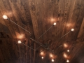 Custom designed and crafted light fixtures adorn the ceiling