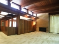 The Living Room with its clerestory windows and stone fireplace