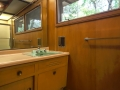 The Master Bath's wood walls and angled cabinetry with original Crane fixtures