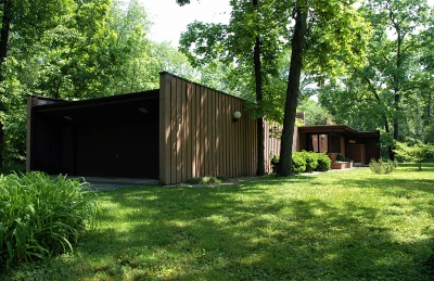 View from the west shows the beauty of the home's site. This end of the house is clad in Redwood.